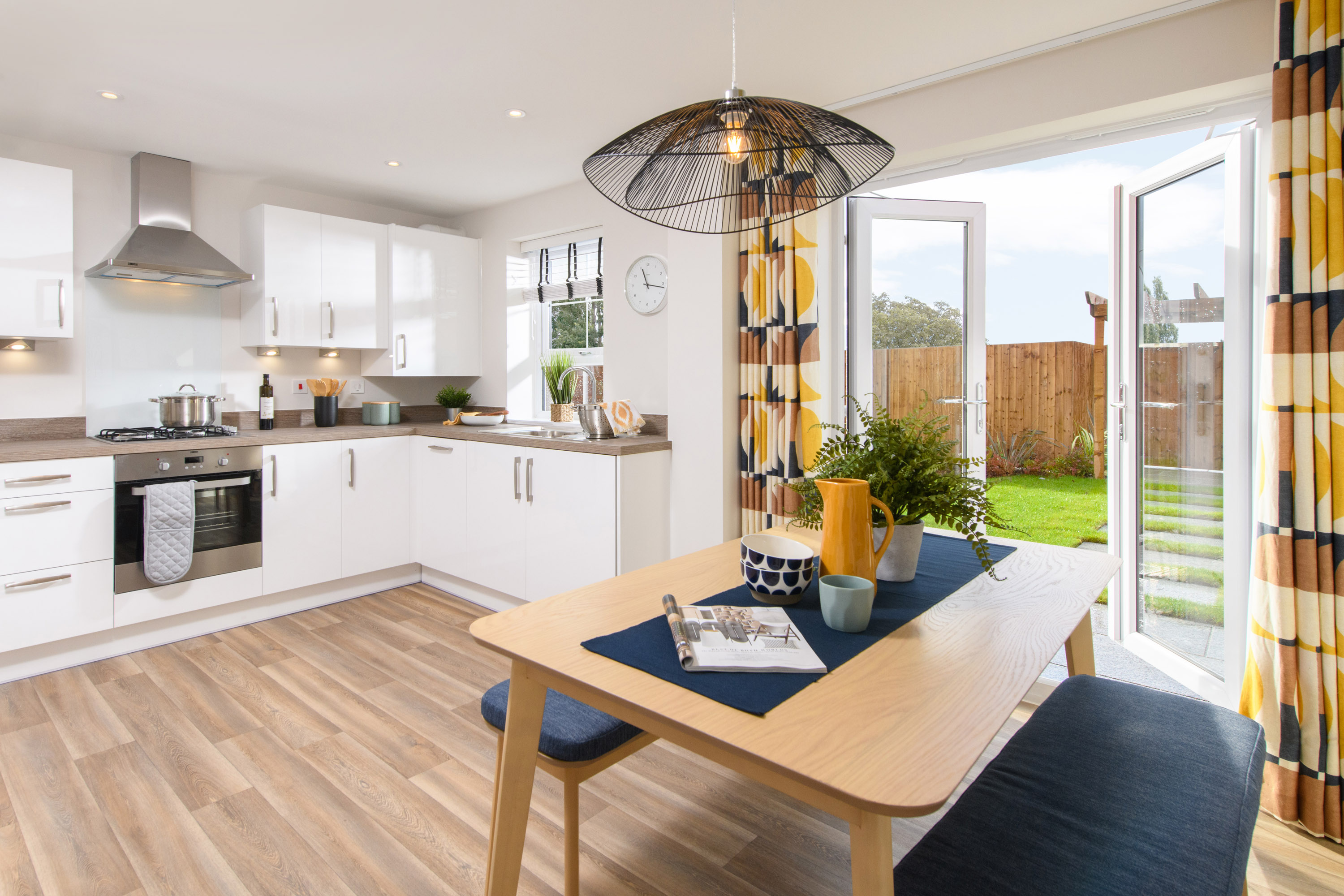 Open-plan kitchen/diner in Maidstone with French doors leading to garden