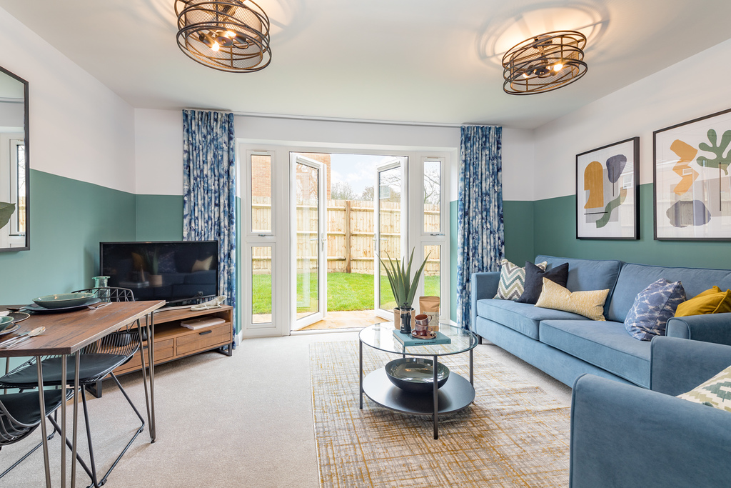 Lounge with french doors to the garden in the Belmont, 2 bedroom home at St George's Gate, Newport