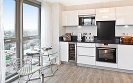 a smart new kitchen with views looking out over london