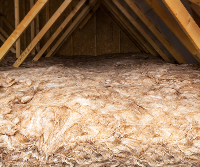 thick insulation lines the roof of a barratt home