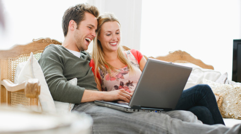Couple sharing laptop