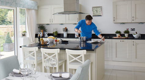 Man in openplan kitchen
